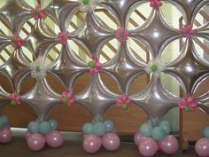 Balloon wall starpoints and pink flowers