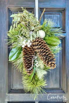 Christmas wreath swag with pine, large sugar pine cones and fresh juniper berries.
