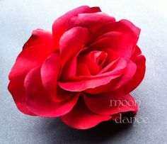 RED Rose with clip on back. Easy to clip onto costume or hair.