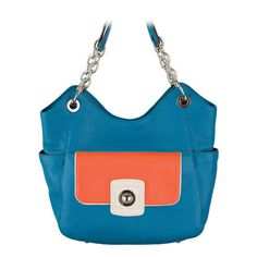 The #GraceAdele Carly-Ocean Bag with the Quinn-Orange Clutch.