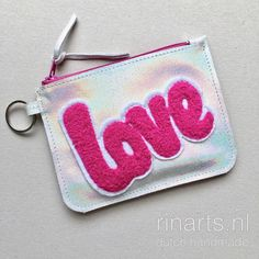 Iridescent rainbow zipper pouch. Zipper pouch with LOVE application