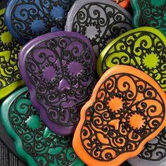 Day of the Dead Cookies - Celebrate Día de Muertos — the Day of the Dead —making traditional skull cookies in updated colors.  The intense teal, blue, green, gray, purple and orange shades are easy to achieve using the Wilton Color Right Performance Color System.