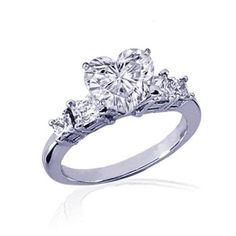 This site gives top ten heart engagement rings for 2013, so awesome.