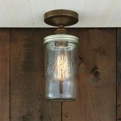 """With a vintage-style design, the Jam Jar Flush Ceiling Light will cast a soft glow over your space. Perfect for low ceilings, this vintage ceiling light is versatile enough to enhance any residential, retail or commercial space. An eye catching design, made from an original """"Le Parfait"""" jar converted into a beautiful ceiling light. #vintagelight #ceilinglight #glasslight #jarlight #flushlight"""