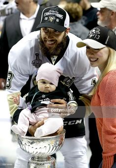 Nick Bonino #13 of the Pittsburgh Penguins celebrates with guests and the Stanley Cup after their 3-1 victory to win the Stanley Cup against the San Jose Sharks in Game Six of the 2016 NHL Stanley Cup Final at SAP Center on June 12, 2016 in San Jose, California.