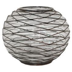 Glass vase with a wire-wrapped design.  Product: VaseConstruction Material: Glass and metal wireColo...