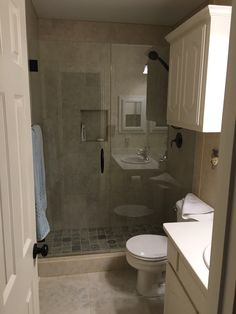 Frameless inline shower with door and stationary panel, Crescent handle in Oil Rubbed Bronze finish