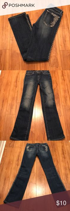 Wrangler Rock 47 Low rise jeans This Wrangler Rock 47 Low Rise Jeans have stitching along the other sides and rhinestones on the pocket. Length 43 inches  Inseam 36.5 inches  Rise 8 inches Wrangler Jeans