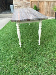 "Table top is reclaimed studs from late 1800s house in Gladewater, Tx.  The legs were found at local antique shop.  ""Stain"" is vinegar and steel wool mix.  Paint is General Finishes Antique White Milk Paint."