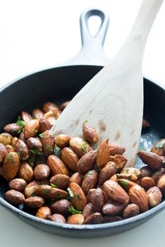 Pan Roasted 5 Minute Spicy Chili Almonds. A super easy to make snack! Tossed with fresh cilantro and spices. | chefsavvy.com #recipe #side #almonds #nuts