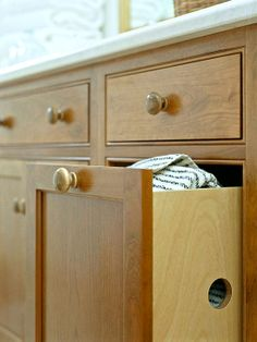 Dirty-Clothes Disposal: Choose cabinets with a built-in hamper feature. Even better is a hamper that can be easily removed to allow you to tote laundry to your washer and dryer. Upstairs Bathrooms, Master Bathroom, Teen Bathrooms, Master Closet, Bathroom Organization, Bathroom Storage, Organization Ideas, Laundry Chute, Laundry Room
