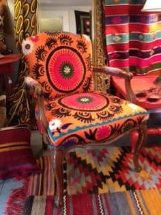 French armchair upholstered in a bright orange by chezboheme, $525.00