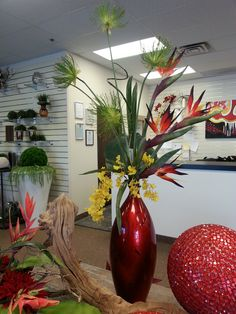 "Tropical Arrangement $100.00 (Dimensions: 47""H x 22""W) www.plantworks.com"