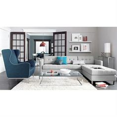 Brown Leather Sectionals Teal Pillows And Burlap Chair On