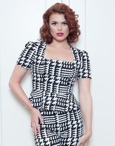 Houndstooth stretch cotton lined peplum top.