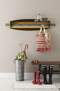 Surfboard coat rack with cleats! More cleat ideas on Completely Coastal here: http://www.completely-coastal.com/2011/04/nautical-boat-cleats-for-hardware-and.html