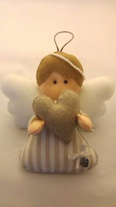 Beige Angel with heart, felt doll, striped cotton fabric, hanging wedding favor for baptism Felt Crafts Diy, New Year's Crafts, Crafts To Do, Christmas Nativity, Christmas Angels, Christmas Crafts, Christmas Ornaments, Star Decorations, Christmas Decorations