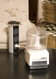 Mockett's Plug Tower telescopes from counter top to provide power to small appliances where needed. #cultivateit