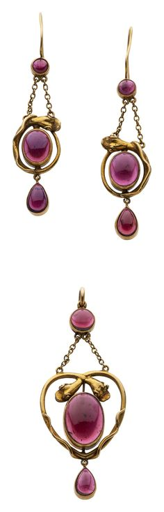 Victorian Garnet, Gold Serpent Suite The suite comprising a pendant and matching pair of earrings featuring oval, round and pear shaped garnet cabochon cut garnets weighing a total of approximately 28.44 carats, in 15k gold
