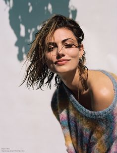 Posing with wet hair, Phoebe Tonkin smiles in multicolored Chloe sweater