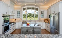 This u-shaped kitchen features a center island for meal prep. The Chesnee house design #1290.