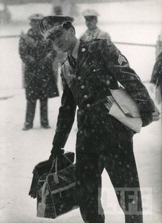 LIFE Magazine: Famous Figures That Shaped the 20th Century | iconic figures that shaped our 20th century | Singer Elvis Presley returns home to the United States in a snow storm after Army service in Germany. 1960.