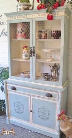 Blue & white painted china cabinet / hutch with French stencils. Painted a vintage soft aqua & antique white with French graphics on cabinet doors & chicken coop wire on the hutch doors. SOLD $495. ~ by SavedandRedeemed on Etsy https://www.etsy.com/listing/231830425/sold-shabby-chic-china-cabinethutch