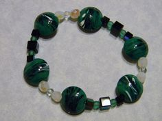 Green, Black and White Art Glass Lampwork, Crystal and Glass Stretch Bracelet