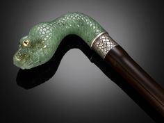 Carved of nephrite jade, the handle of this rare cane takes the form of deadly serpent ~ M.S. Rau Antiques