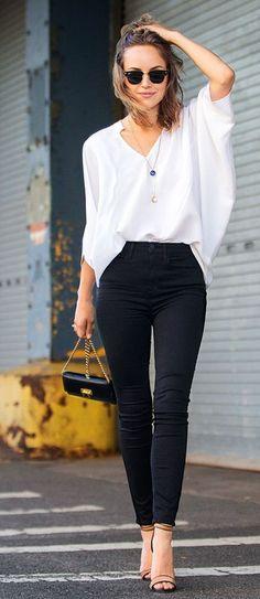 — Black Sunglasses — Blue Pendant — White Long Sleeve Blouse — Black Skinny Jeans — Black Leather Crossbody Bag — Tan Leather Heeled Sandals