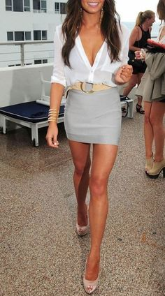 i love this whole look! white plunging blouse with a grey skirt and pink pumps