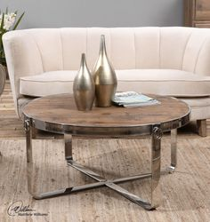 RBG Home Store - Berdine, Round Wood and Stainless Steel Coffee Table, $844.00 (http://www.rbghomestore.com/berdine-round-wood-and-stainless-steel-coffee-table/)