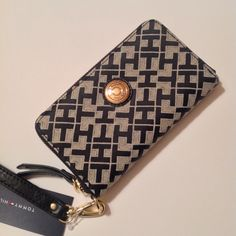 TH Wallet Gorgeous wallet with cream colored design and lovely gold tone zipper all around. Several cash/card slots. Detachable Wristlet. MSRP: 58$ Tommy Hilfiger Bags Wallets