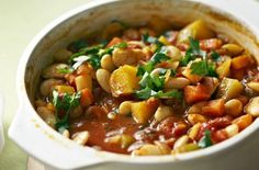 Our quick, cheap and easy to make vegetable stew has been taken from our January 1943 issue. This recipe has been speeded up by swapping haricot beans for canned butter beans. Raw Food Recipes, Vegetable Recipes, Vegetarian Recipes, Dinner Recipes, Healthy Recipes, Vegetable Stew, Canned Butter, Roast Dinner, Vegetarische Rezepte