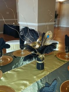 Centerpieces design for a black and gold masquerade party. Masquerade Party Themes, Masquerade Party Centerpieces, Masquerade Ball Decorations, Homecoming Decorations, Homecoming Themes, Mardi Gras Centerpieces, Masquerade Wedding, Balloon Centerpieces, Wedding Centerpieces