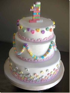 This cake is so sweet!  I love the #1 made out of lego candy.