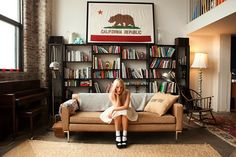 Opening Ceremony buyer Kate Foley's Williamsburg apartment --- framed CA flag = a must have Apartment Chic, Apartment Living, Apartment Ideas, Seattle Apartment, Williamsburg Apartment, Large Bookcase, Bookcases, Apartment Bookshelves, Behind Couch