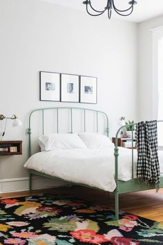Home Decor – Bedrooms : I love the green bed frame! Feminine yet minimal bedroom with a floral area rug, a white sconce, and a green metal bed frame -Read More – Cama Ikea, Ikea Bed Hack, Ikea Hacks, Bed Ikea, White Ikea Bed, Minimal Bedroom, Minimal Bed Frame, Feminine Bedroom, Simple Bed Frame