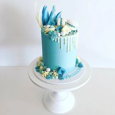 Blue offside drip signature cake