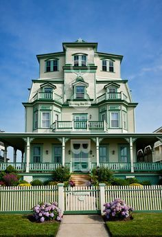 I love the appropriately beachy mint color palette on this grand Victorian in Cape May, NJ