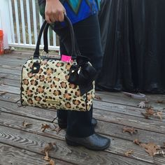 BETSEY JOHNSON satchel Black bottom and handles.  Signature black bow with round jewel charm.  Quilted hearts on beige, brown, black and light green animal print.  Gold hardware.  Dark pink lining with pink scrolls of roses and lips.  Be Mine cheetah.  There are sporadic tiny black dots in front and bottom of one side but they're part of the pattern, not scratches or holes (I inspected carefully). Betsey Johnson Bags Satchels
