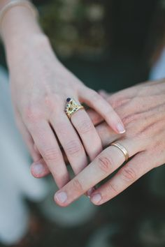 This image from Jasmine Fitzwilliam of Let's Frolic Together, features a 9ct yellow gold Landscape wedding band of Arthur's Seat in Edinburgh made by me!