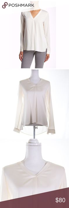 Theory Tralena Ivory 2 Silk Blend Blouse Size S Stretch silk offers the most in luxurious feel and easy motion on a minimalist V-neck top.  Pre-loved and in great condition, looks new.  Size Small Theory Tops