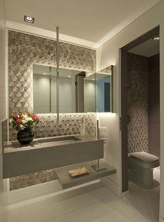 Projeto de lavabo utilizando tons neutros e acinzentados.