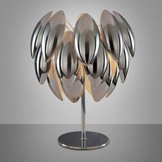 The lamp with a chromed metal frame and aluminum and chrome-colored aluminum shells necessarily has its place in your home. Design is the perfect word for this fixture which is at the forefront of fashion. #bedroomdecor #concept #lamp #lampshade #lightbulb #lightfixture #lighting #lightingdesign #metallic #modernlighting #steel