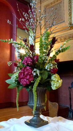 arrangement made with purple and green hydrangea, bells of Ireland, white snapdragon and white aster.