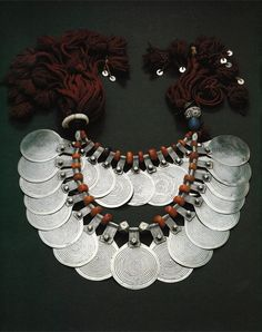 Morocco | Woman's necklace from Tiznit | Silver, amber and shell || Ghysels Collection, photograph John Bigelow Taylor