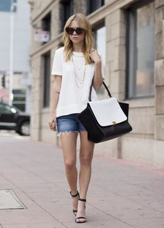 Fashion influencer Always Judging stays casual cool with J BRAND Cut-offs and a statement bag.