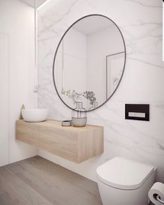 Mirror mirror on the wall who is the fairest of them all?  The mirror of course!  Our usual kind of bathroom by yet again the team of @minosa_design.  Marble walls timber vanity and concrete details... What more can you ask for?  A statement mirror to finish it all off. by simple.form