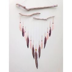 Boho feather wall hanging by Inspired Soul Shop on Etsy. This driftwood and feather hanging was inspired by whimsical dreamcatchers and is